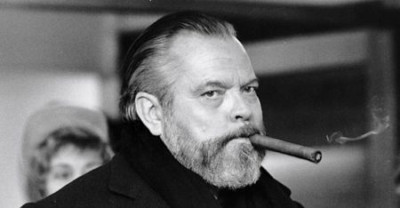 Orson Welles smokes long cigar
