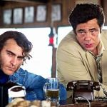 Inherent Vice's Joaquiin Phoenix and Benicio Del Toro confer at bar
