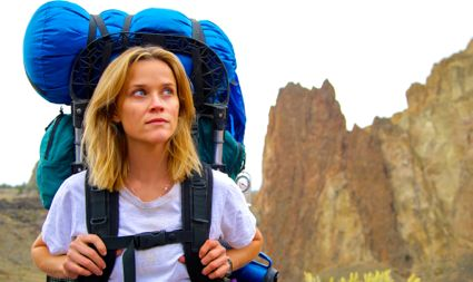 Wild's Reese Witherspoon shoulders backpack as she hikes on rugged trail