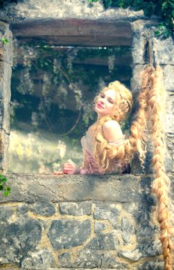 Into the Woods' MacKenzie Mauzy as Rapunzel lets her long blonde hair down from fortress window