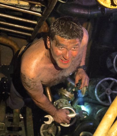 Black Sea's shirtless Sergey Puskepalis looks up from job fixing a broken sub