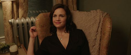 Match's Carla Gugino in chair looks left
