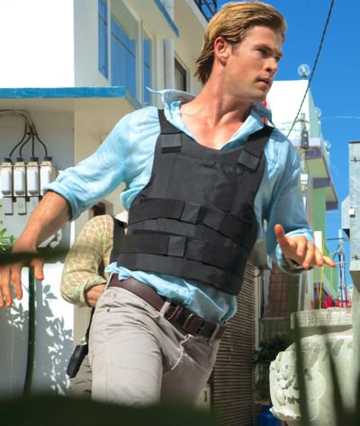 Blackhat's Chris Hemsworth races around a corner in Hong Kong's backstreets