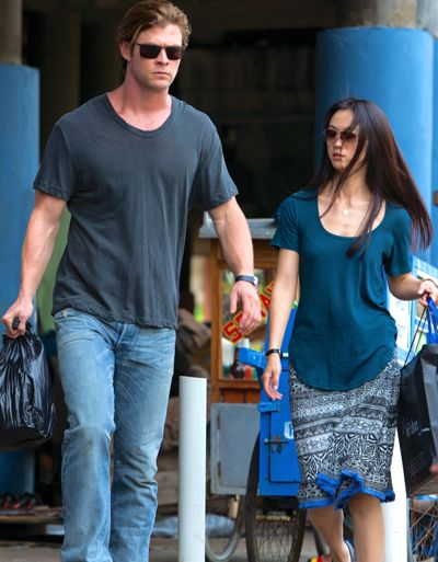 Blackhat's Chris Hemsworth and Chen Lien carry bags in airport