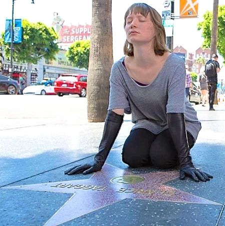 Maps to the Star's Mia Wasikowska kneels down on Holllywood Blvd.