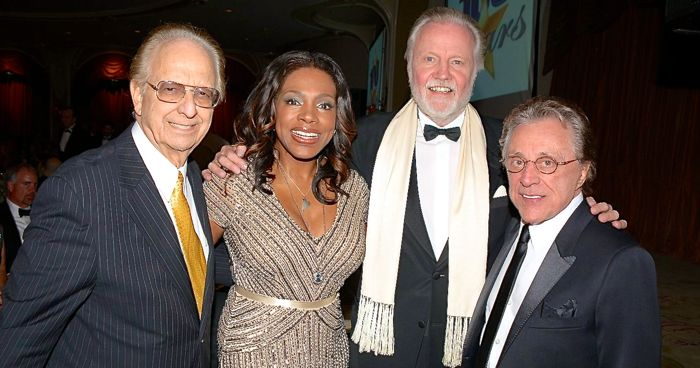 Norby Walters greets Sheryl Lee Ralph, Jon Voight, Frankie Valli