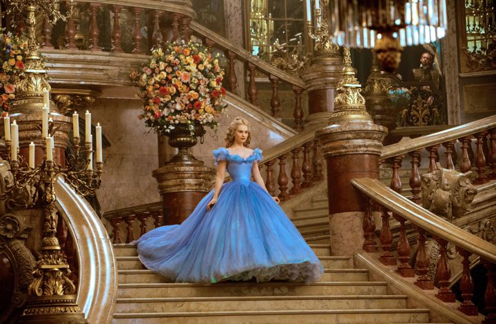Lily James' Cinderella sweeps down staircase in blue glown