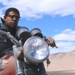 Two Men in Town's Forest Whitaker rides motorcycle in desert