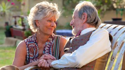 Second Best Exotic Marigold Hotel's Diana Hardcastle and Ronald Pickup cuddle in their seats