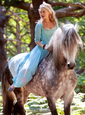 Lily James' Cinderella rides horse in woods