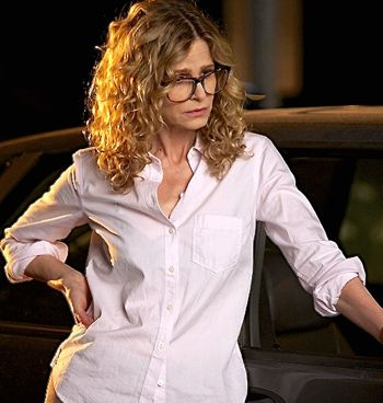 Road Within's Kyra Sedgwick leans against car at night