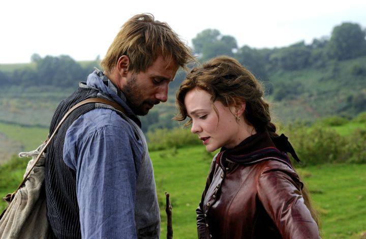 Far From Madding Crowd's MatthiasSchoenaerts and Carey Mulligan touch heads in midst of sheep farm