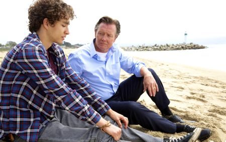 Road Within's Robert Sheehan sits on beach with dad Robert Patrick