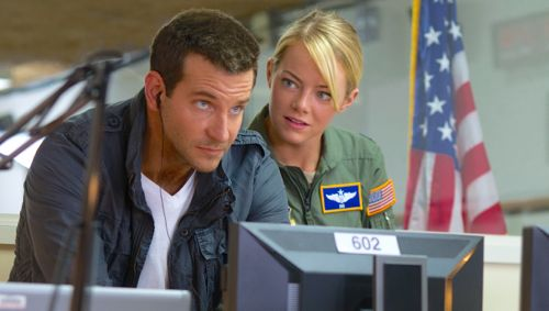 Aloha's Bradley Cooper and Emma Stone work on computer