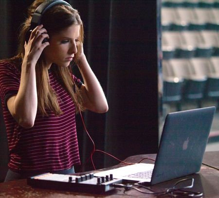 Pitch Perfect 2's Anna Kendrick listens to playback on laptop