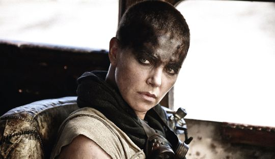 Mad Max's Charlize Theron stares out of War Rig's side window