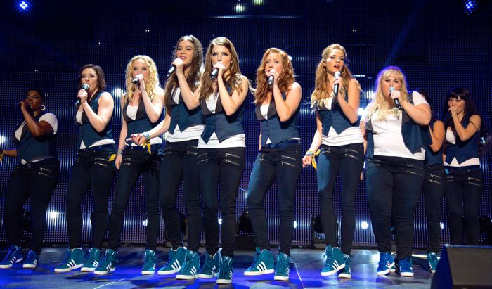 Pitch Perfect 2 cast sing on stage