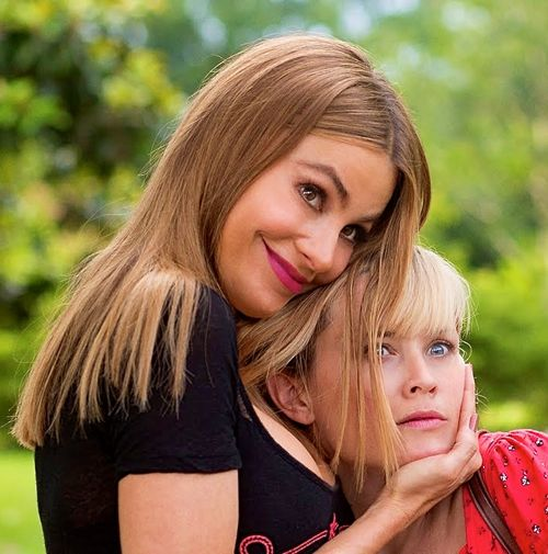 Hot Pursuit's Sofia Vergara cradles Reese Witherspoon's head