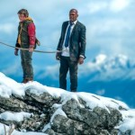 Big Game's Samuel L. Jackson and Onni Tommila, clutching a bow, stand on mountain top