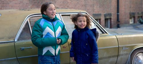 Infinitely Polar Bear's Imogene Wolodarsky, Ashley Aufderheide stand beside family car