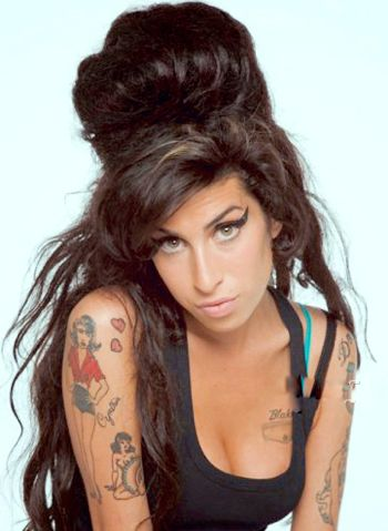 Amy Winehouse stares seductively at camera