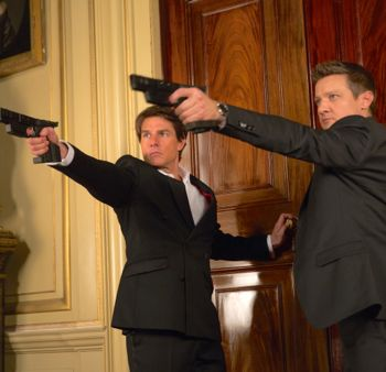 Mission Impossible's Tom Cruise and Jeremy Renner fire pistols