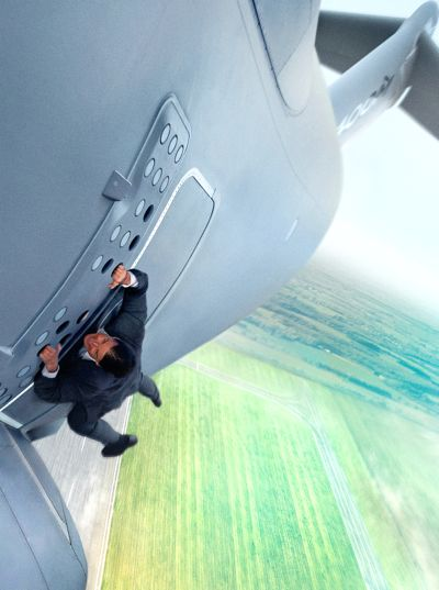 Mission Impossible's Tom Cruise hangs onto cargo plane on takeoff