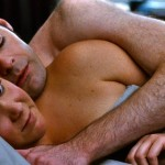 Trainwreck's Amy Schumer is wide eyed in bed with a sleeping Bill Hader
