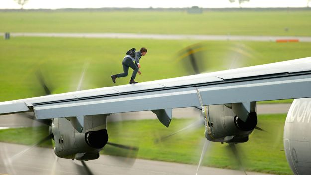 Mission Impossible's Tom Cruise dashes along wing of cargo plane on runaway