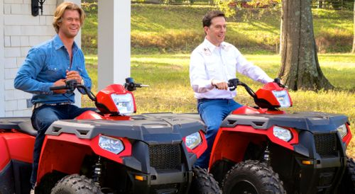 Vacation's Chris Hemsworthand Ed Helms sits aboard cow-hearding motorized vehicles