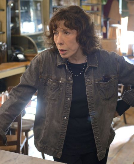 Grandma's Lily Tomlin leans against cafe counter