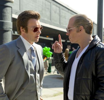 Black Mass' Johnny Depp makes point to Joel Edgerton with his right-hand finger