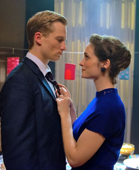 Labyrinth of Lies' Frederike Becht adjusts Alexander Fehling's tie