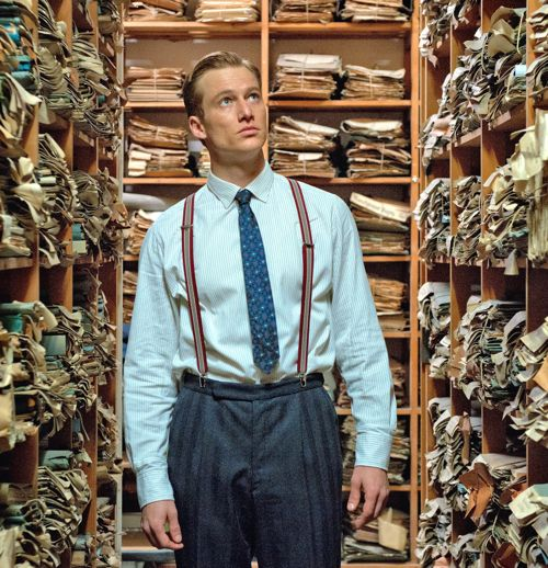 Labyrinth of Lies' Alexander Fehling stares up at shelves of Nazi documents