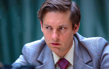 Pawn Sacrifice's Tobey Maguire intensely studies chessboard
