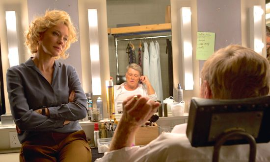 Truth's Cate Blanchett talks to her boss, Robert Redford, who face we see in mirror