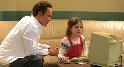 Steve Jobs' Michael Fassbender shows young Makenzie Moss the Macintosh computer on table