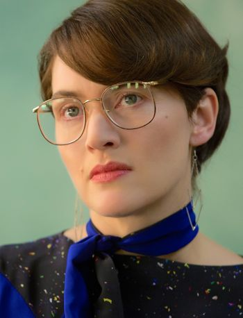 Steve Jobs' Kate Winslet looks serious and stares into camera