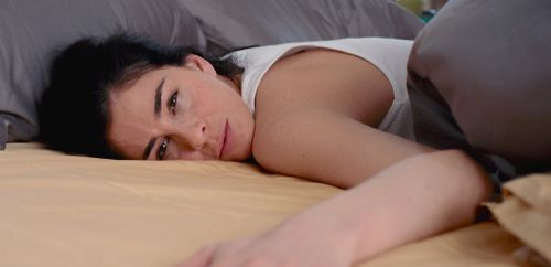 I Smile Back's Sarah Silverman lies in bed facing camera