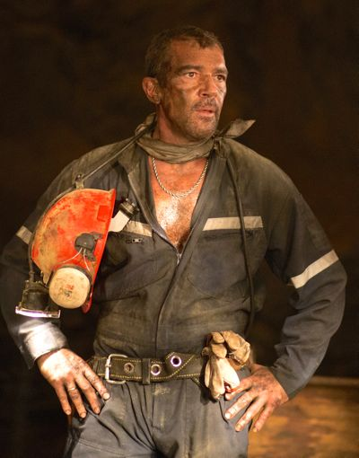 The 33's ANtonio Banderas stands with hands on hips in depths of buried gold mine