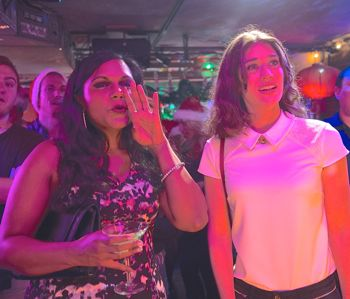 Night Before's Mindy Kaling and Lizzy Caplan watch karoke in New York bar
