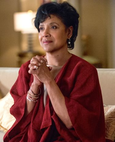 Creed's Phylicia Rashad grips hands as she watches her son box on TV