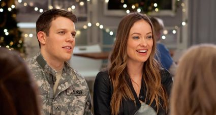 Love Cooper's Olivia Wilde and Jake Lacy sit at Christmas Eve dinner table