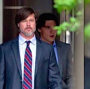 Big Short's Brad Pitt walks out of building