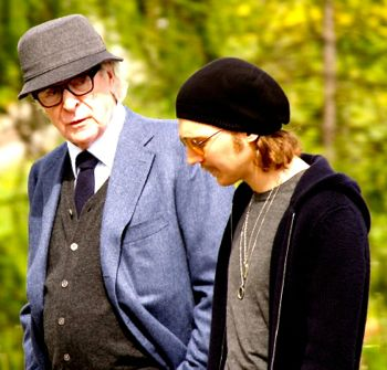 Youth's Michael Caine and Paul Dano stroll in Alpine woods
