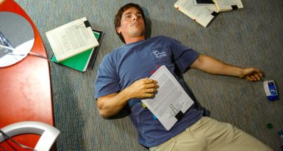Big Short's Christian Bale lies on office floor surrounded by research papers