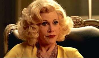 Youth's Jane Fonda in blonde wig and thick makeup looks off camera