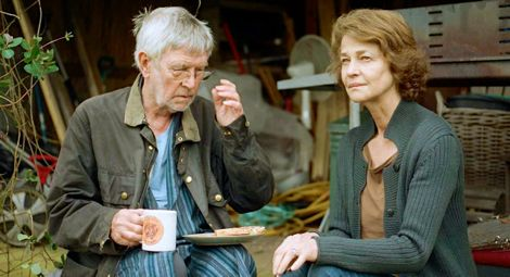 45 Yecars' Tom Courtenay and Charlotte Rampling sit and talk while having morning tea
