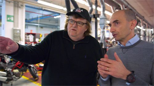 Where to Invade's Michael Moore does interview in factory