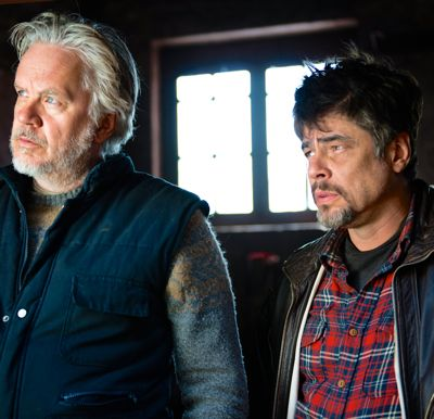 A Perfect Day's Benicio Del Toro, Tim Robbins stare in wonderment as humanitarian aid workers at a fresh new hell